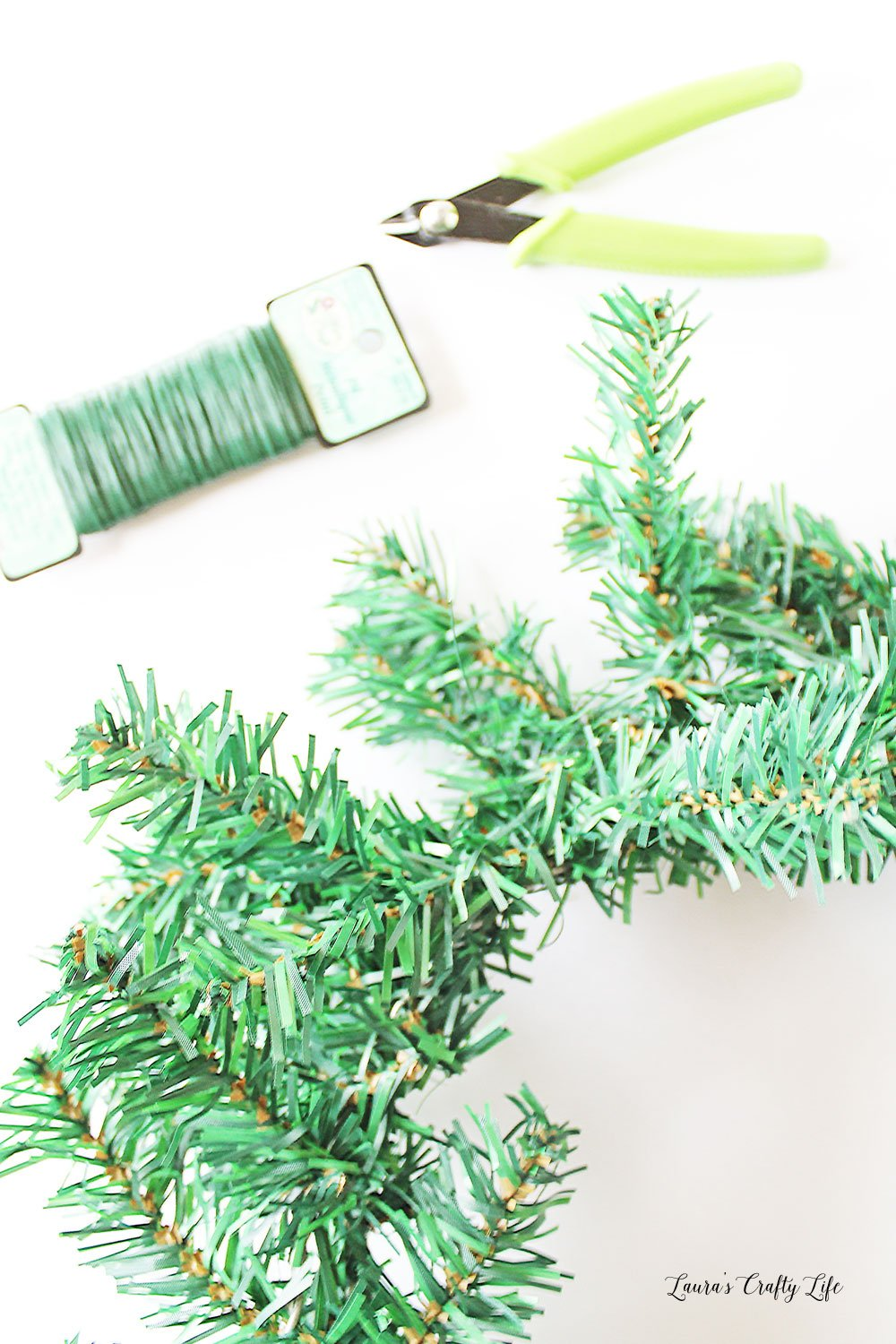 Twist together two wreaths from Dollar Tree