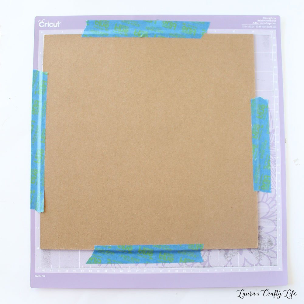 Use tape to hold chipboard on mat