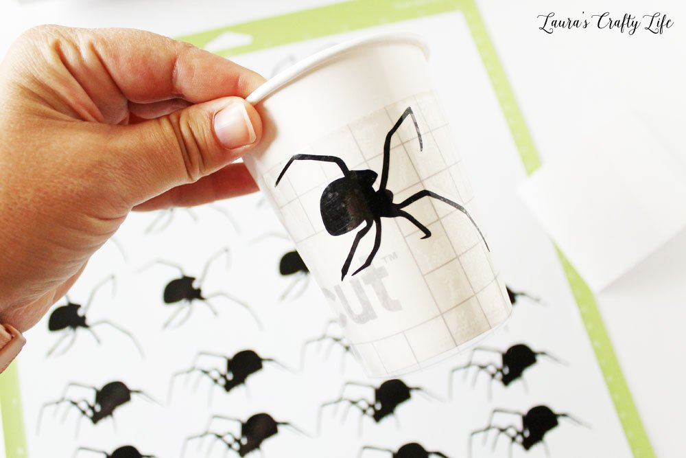 Use transfer tape to move vinyl spiders to cups