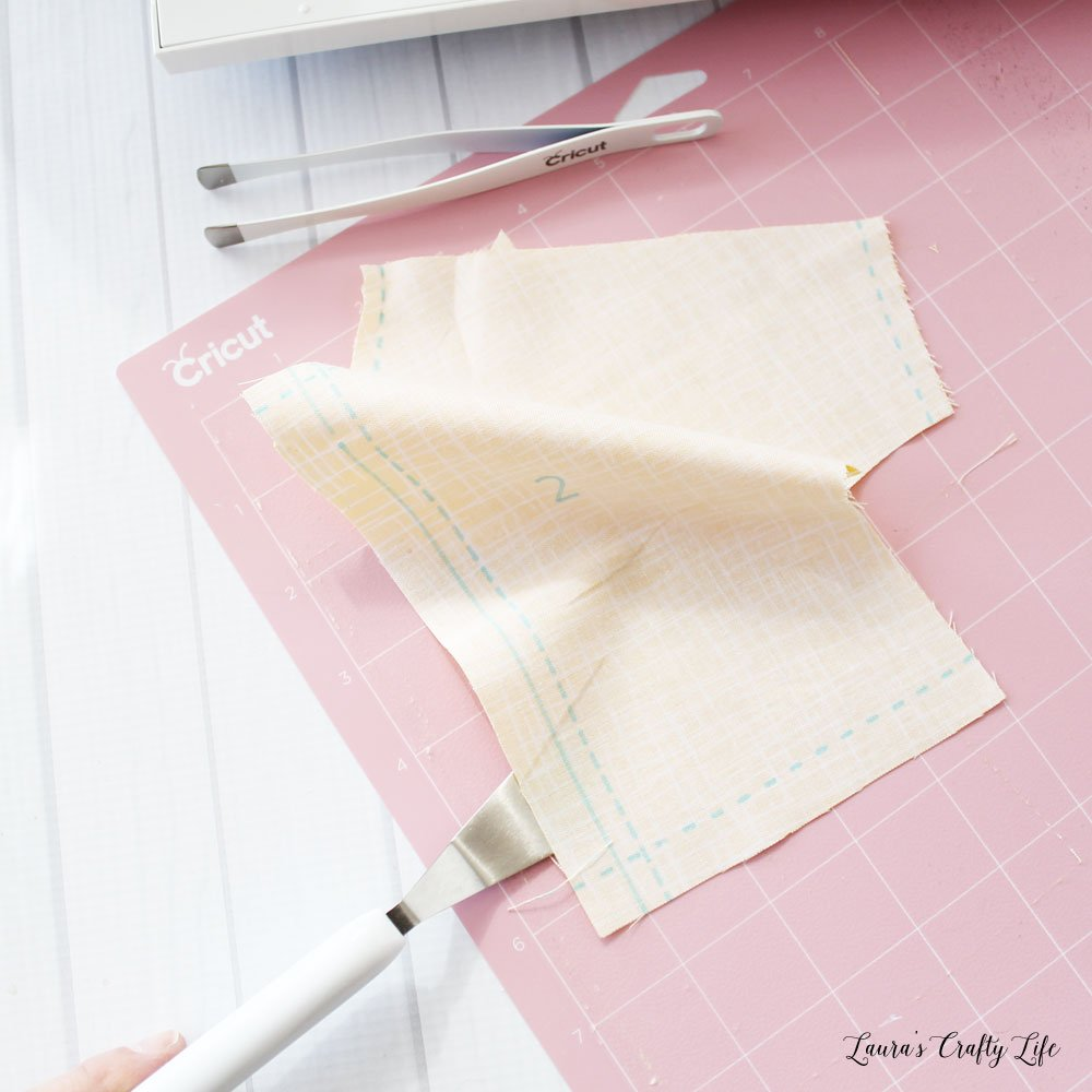 Use spatula to remove fabric from mat