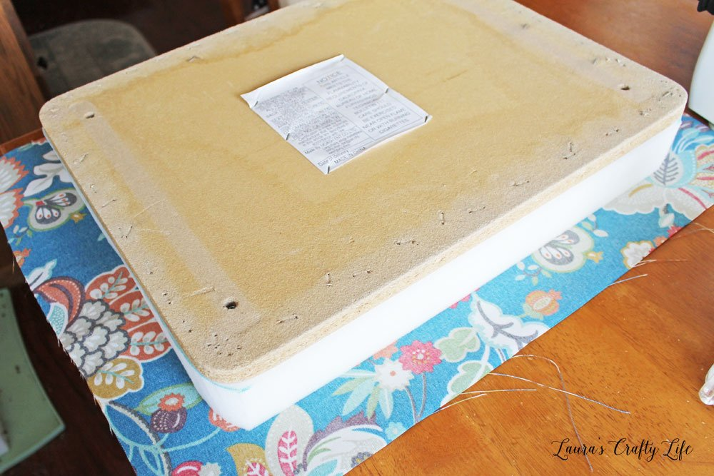 Layer fabric foam and wood to reupholster ottoman