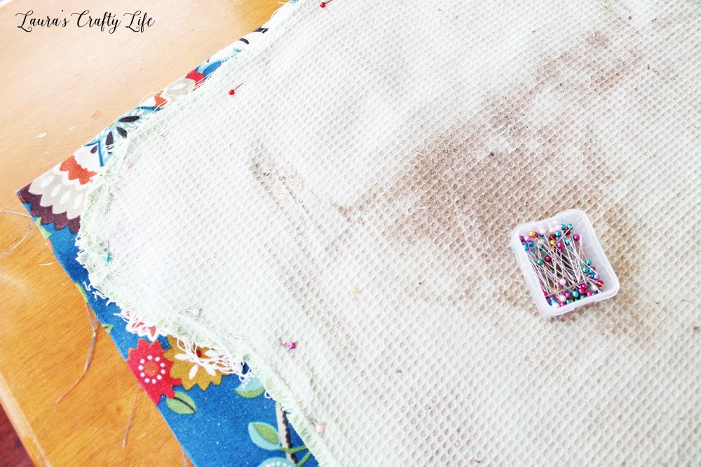 Pin the old cushion pieces to your new fabric