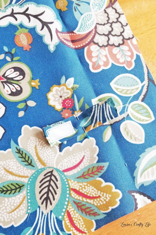 Sew velcro tabs on fabric