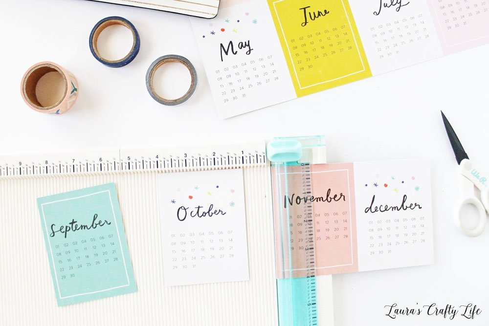 Use paper trimmer to cut calendars apart