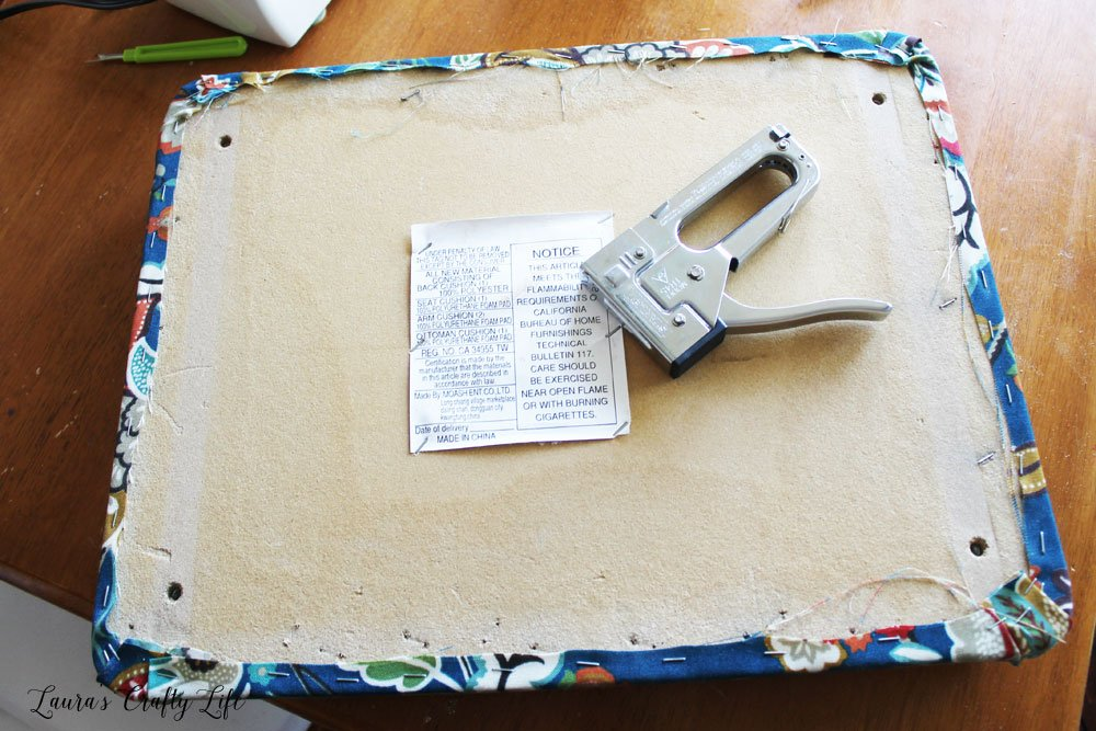 Use staple gun to reupholster ottoman