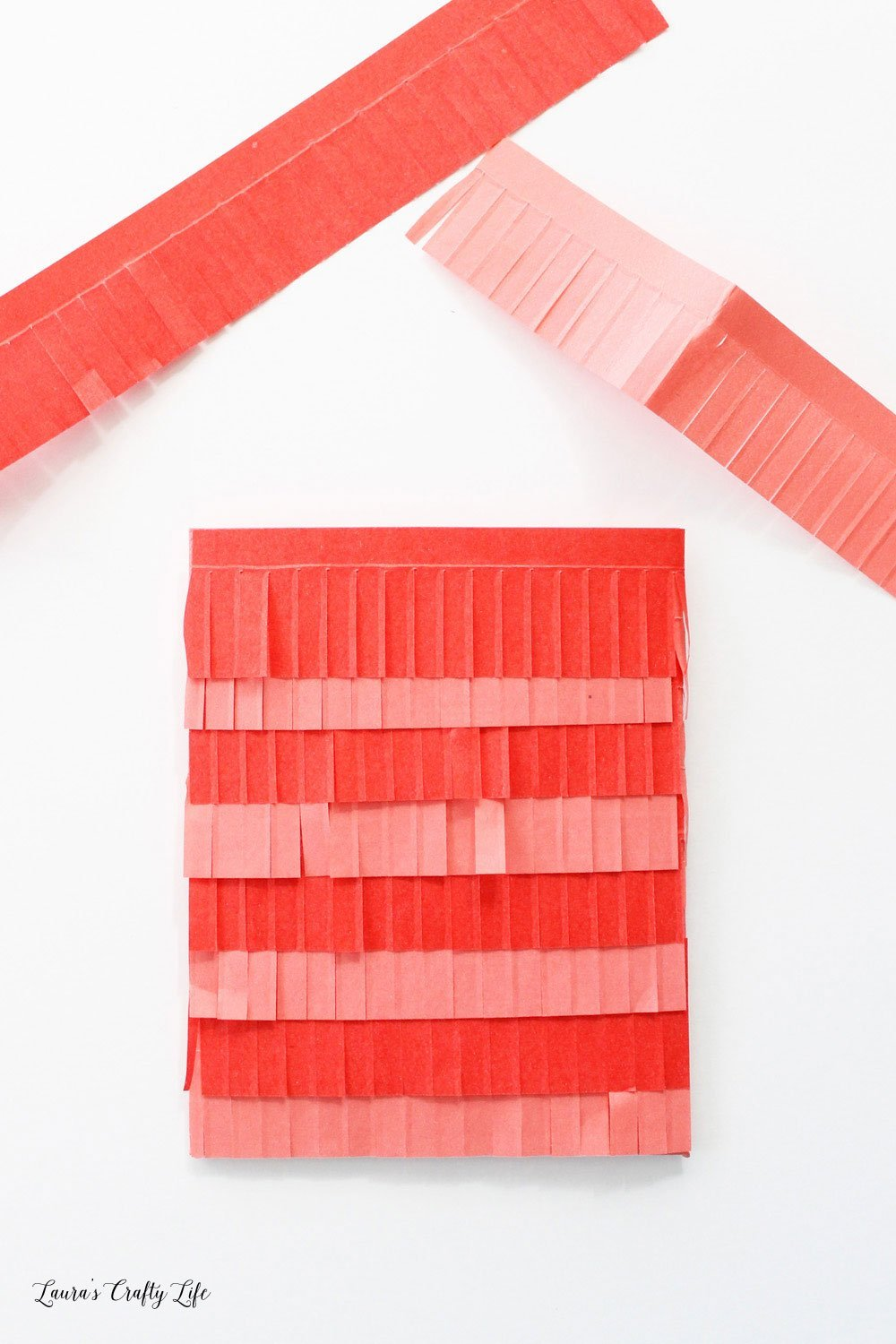 Alternate pink and red fringe tape on the envelope