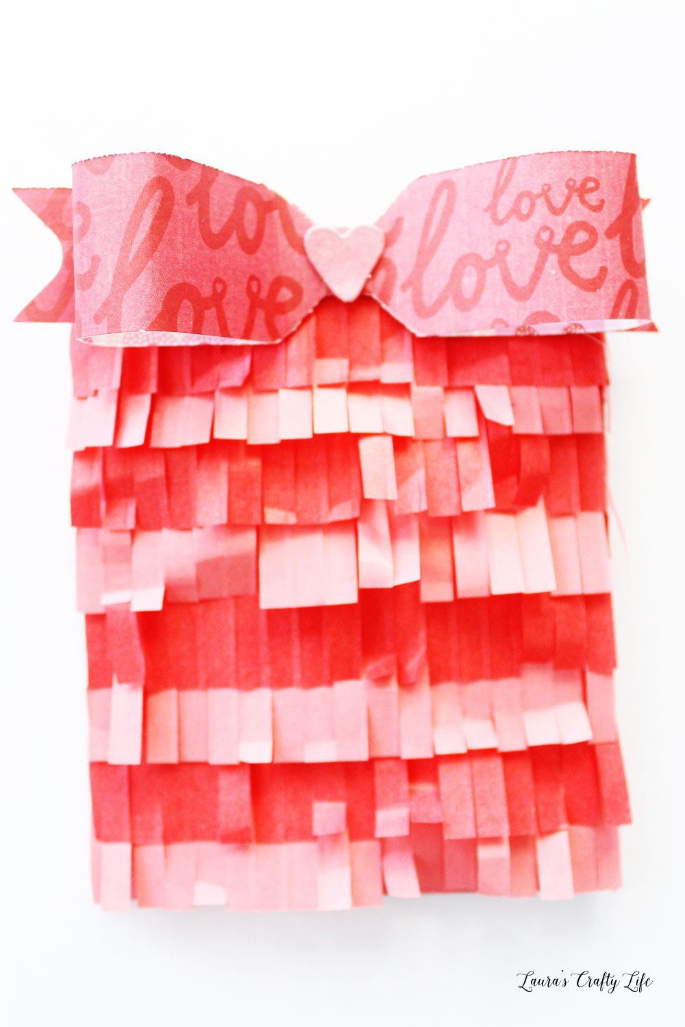 Create a pretty fringed envelope for Valentine's Day using the 1-2-3 punch board