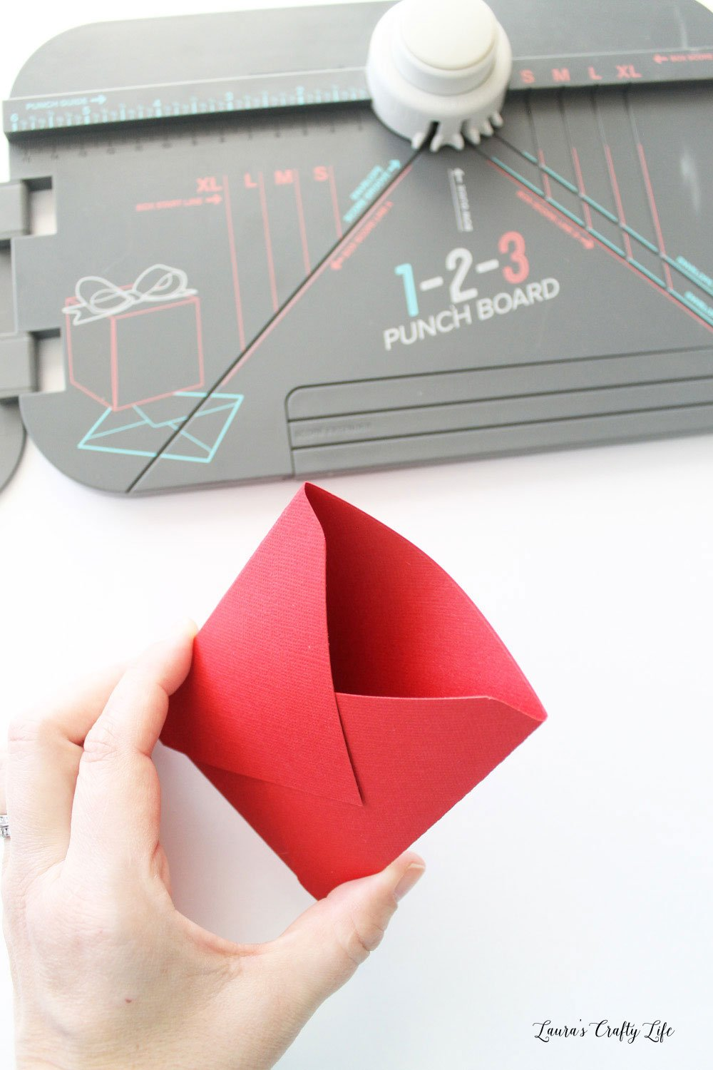 Trim off one flap of the envelope to create a pocket