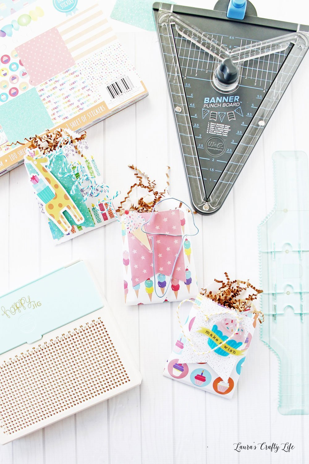 Create birthday treat bags using We R Memory Keepers tools - happy jig, goodie bag guide, and banner punch board. #laurascraftylife #wermemorykeepers #birthday