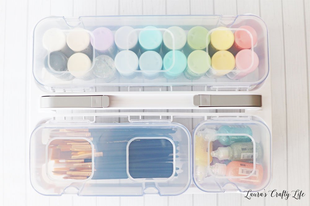 Deflecto caddy organizer filled with paint and brushes