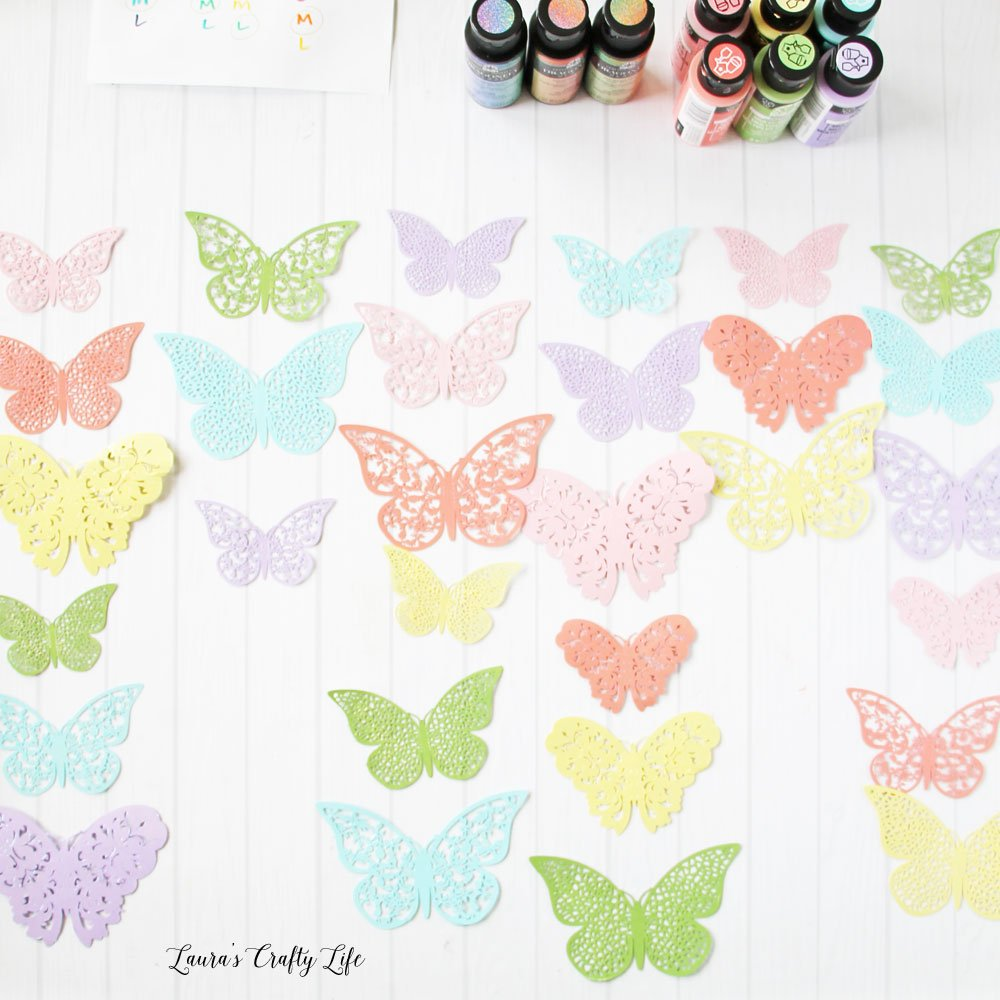 Arrange butterflies before gluing onto fishing line