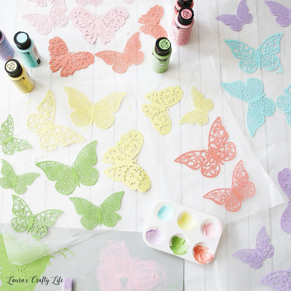 Paint each butterfly with two coats of paint