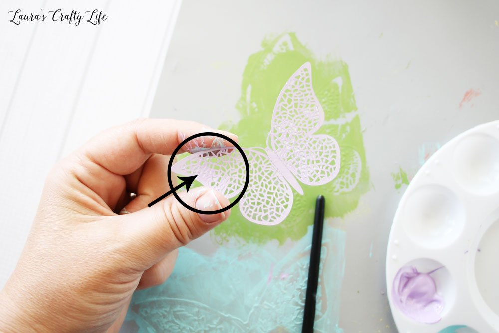 Use paint brush to remove excess paint from holes