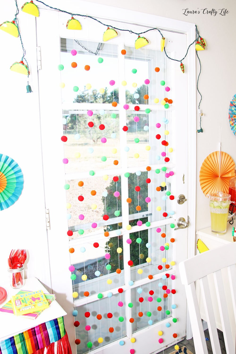 Pom pom door hanging and taco string lights