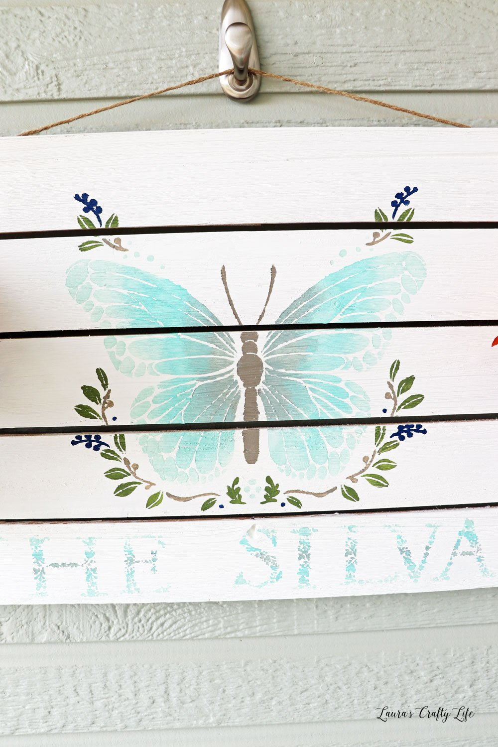 Close up of painted butterfly sign