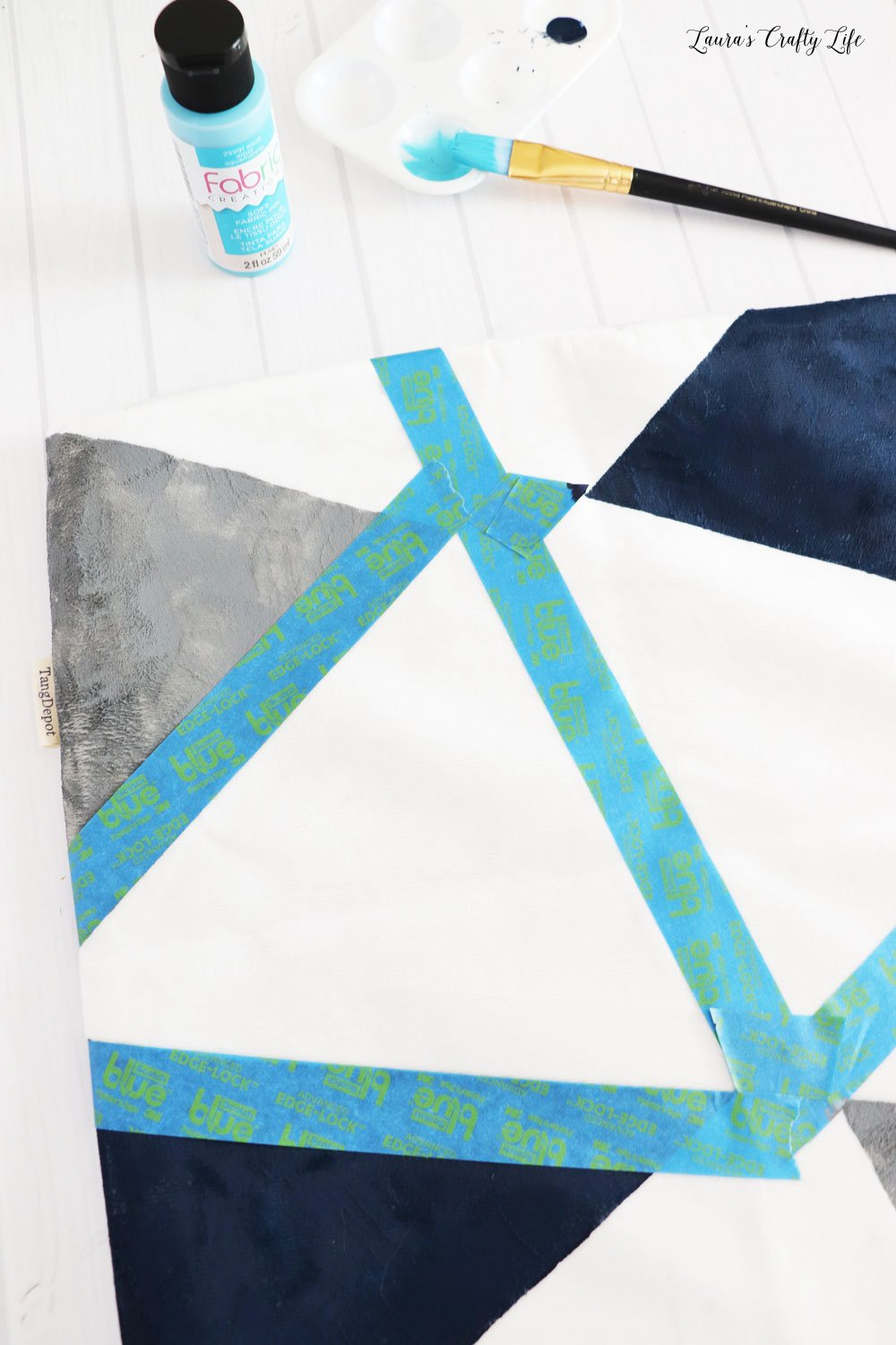 Continue taping and painting color block pillow
