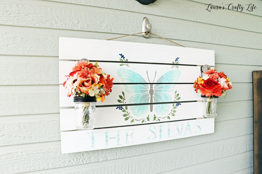 Hand painted sign with glass jars