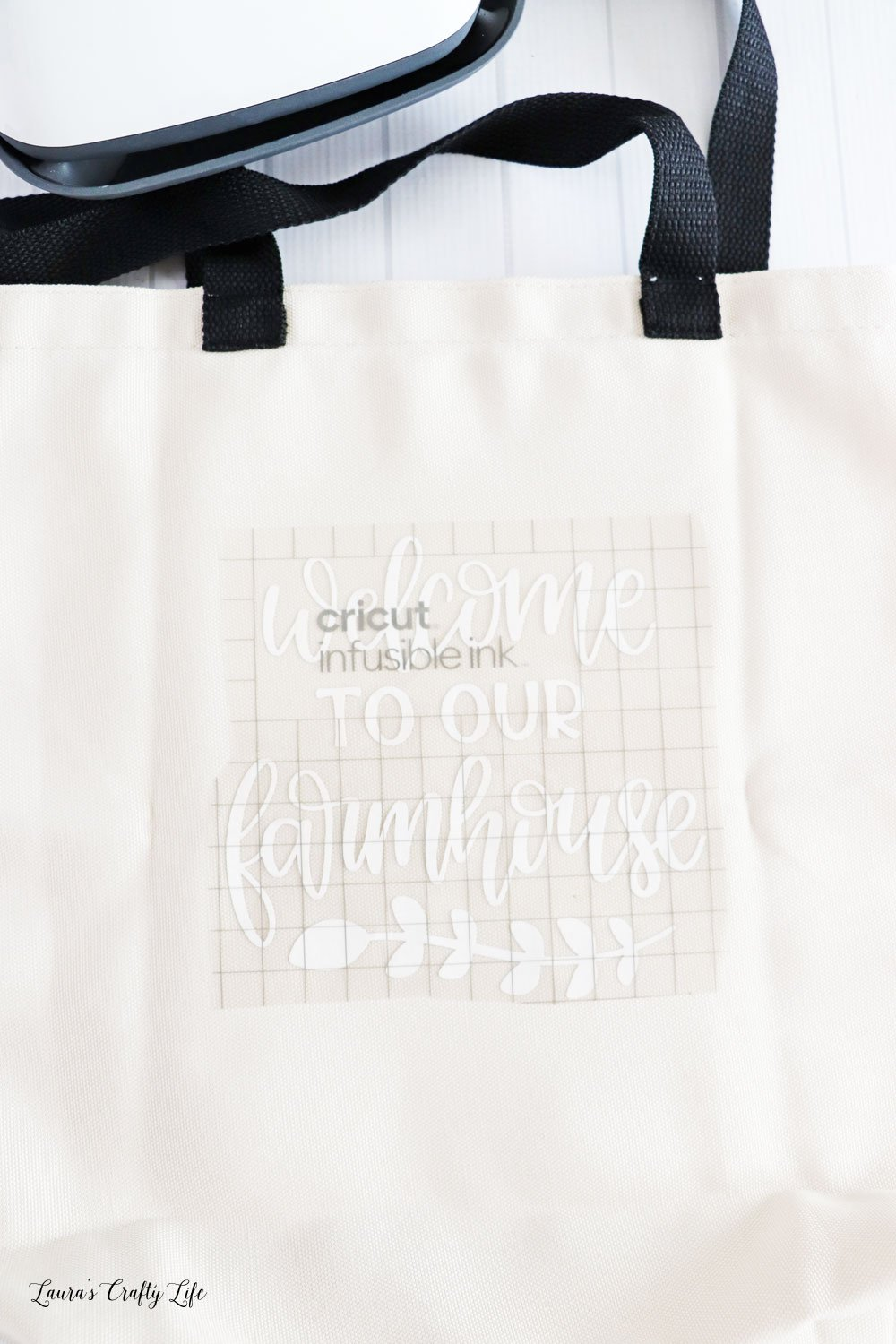 Place infusible ink transfer sheet on tote with liner up