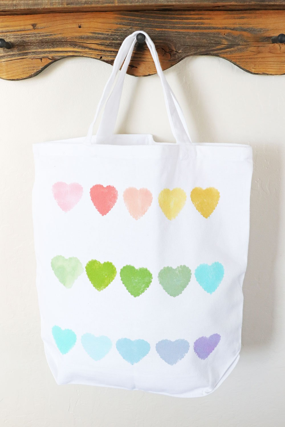 DIY painted rainbow heart tote bag