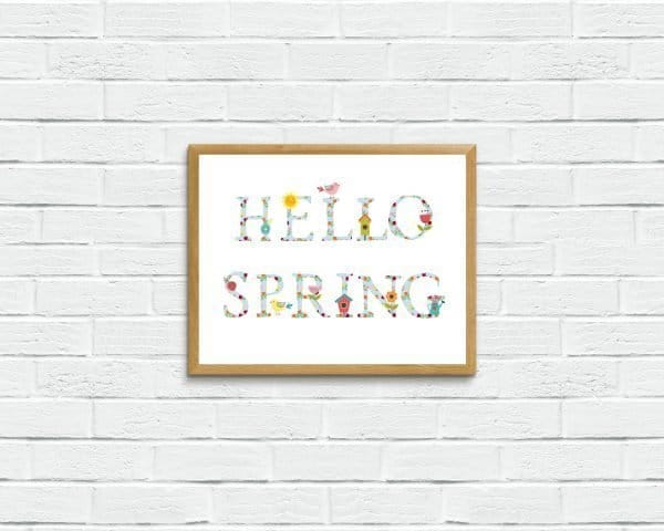 hello spring on brick wall