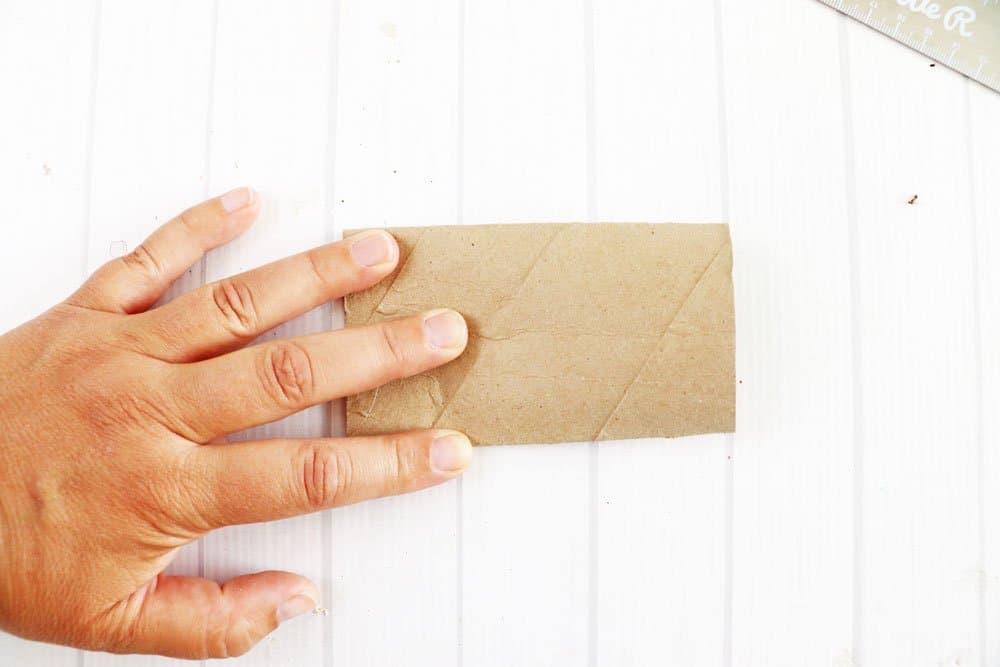 flatten toilet paper roll