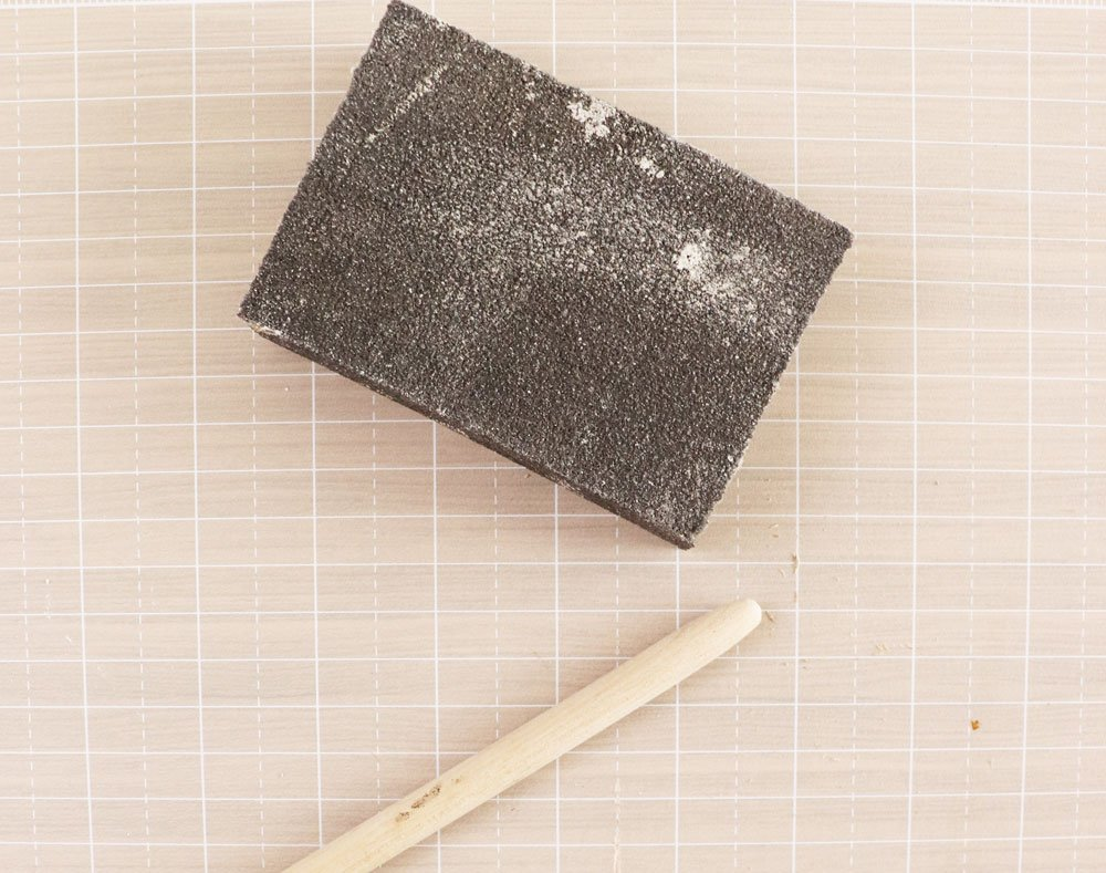 sand end of dowel rod