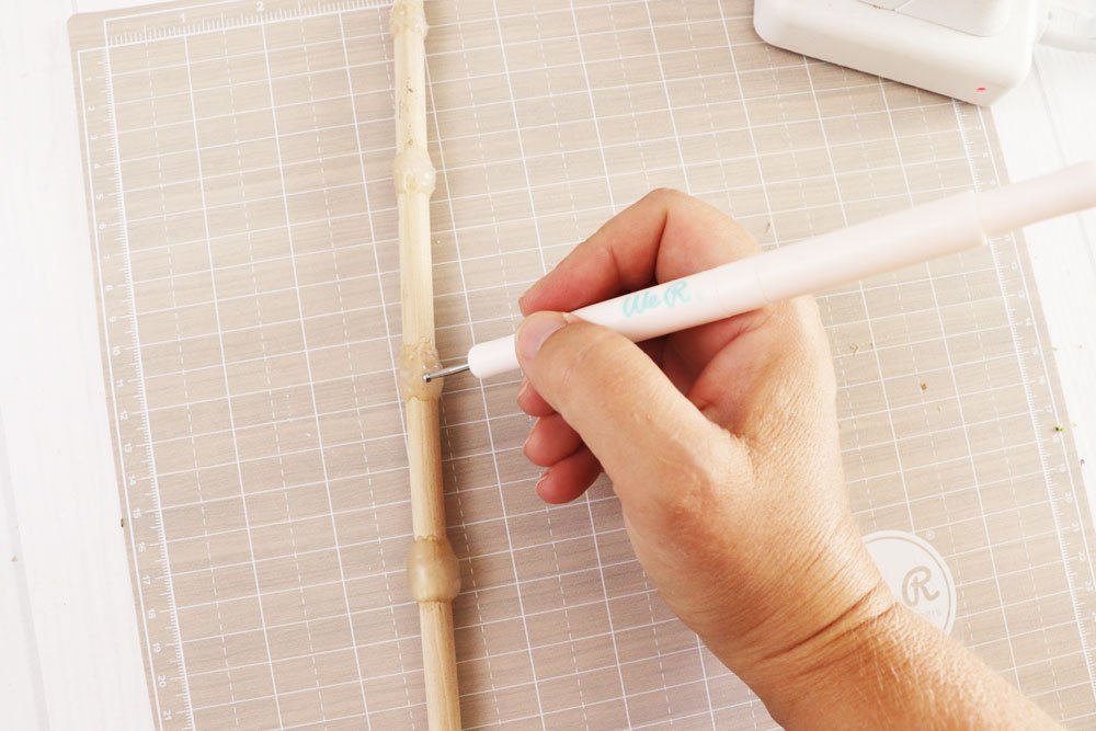 use embossing stylus to create design in hot glue