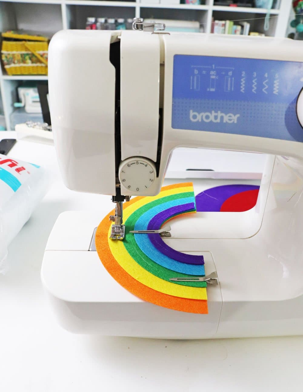 sew together rainbow felt pieces