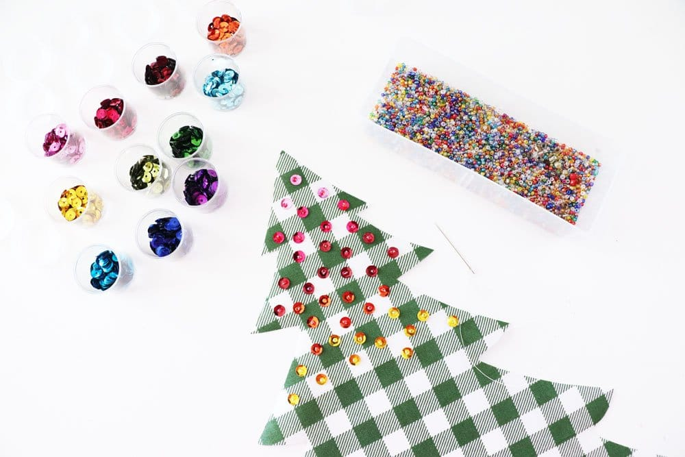 sew on sequins to tree