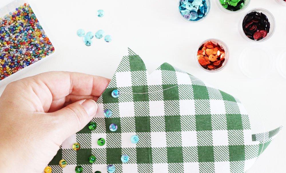 thread needle through sequin and bead