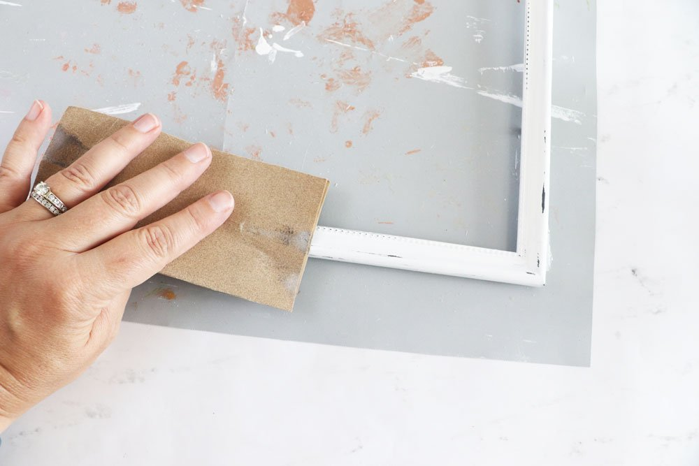 lightly sand to distress frame